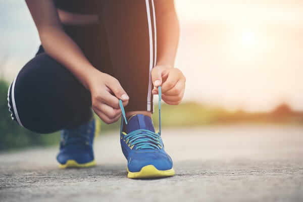 Close up shoes Female runner tying her shoes for a jogging exercise
